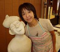 Yukari and one of her creations in progress